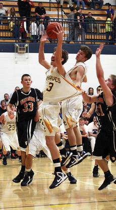 """<div class=""""source""""></div><div class=""""image-desc"""">GCHS Braves' Aaron Hicks and Logan Cummins fight their way past Chaz Jordan and Drew Harris, both Williamstown Demons' for a basket when the cross county rivals met at GCHS on Dec. 4. Right, Aaron Hciks tries to block David Jump. Photos by Annette Crimmins</div><div class=""""buy-pic""""><a href=""""/photo_select/16460"""">Buy this photo</a></div>"""