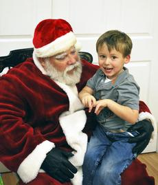 "<div class=""source""></div><div class=""image-desc"">Jayden Brewer is happy to tell Santa what he wants for Christmas. Photo by Camille McClanahan</div><div class=""buy-pic""><a href=""http://web2.lcni5.com/cgi-bin/c2newbuyphoto.cgi?pub=195&orig=pic%2B1_43.jpg"" target=""_new"">Buy this photo</a></div>"