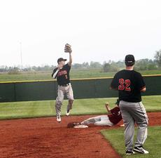 "<div class=""source""></div><div class=""image-desc"">Drew Harris jumps for a catch against a Henry County runner on May 9 in the first round of the North Central Kentucky Conference as Derek Cummins watches. </div><div class=""buy-pic""><a href=""http://web2.lcni5.com/cgi-bin/c2newbuyphoto.cgi?pub=195&orig=pic%2B1_78.jpg"" target=""_new"">Buy this photo</a></div>"