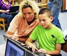 """<div class=""""source""""></div><div class=""""image-desc"""">Angel Donley points at the screen as Matthew Donley shows her the computer program he made in the STLP and Robotics class. </div><div class=""""buy-pic""""><a href=""""/photo_select/17911"""">Buy this photo</a></div>"""