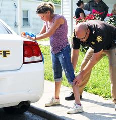 """<div class=""""source"""">Camille McClanahan</div><div class=""""image-desc"""">Marylyn Abney is patted down by a sheriff's deputy during her arrest.</div><div class=""""buy-pic""""><a href=""""http://web2.lcni5.com/cgi-bin/c2newbuyphoto.cgi?pub=195&orig=pic%2B1_97.jpg"""" target=""""_new"""">Buy this photo</a></div>"""