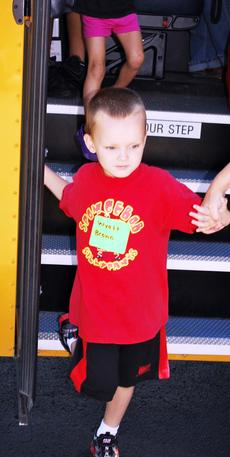 "<div class=""source""></div><div class=""image-desc"">Wyatt Brown, a soon-to-be kindergartner, needs a little help getting off the school bus. </div><div class=""buy-pic""><a href=""/photo_select/18468"">Buy this photo</a></div>"