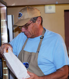 """<div class=""""source""""></div><div class=""""image-desc"""">Pat Grillo, manager of Beans, gets a customer a donut. Photo by Camille McClanahan </div><div class=""""buy-pic""""><a href=""""http://web2.lcni5.com/cgi-bin/c2newbuyphoto.cgi?pub=195&orig=pic%2B2.jpg"""" target=""""_new"""">Buy this photo</a></div>"""