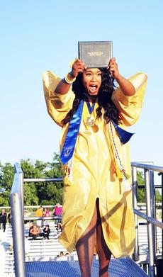 "<div class=""source""></div><div class=""image-desc"">Rikel Taro can't contain her excitement as she walks off the stage after getting her diploma at the Grant County High School graduation on May 24. Photo by Camille McClanahan </div><div class=""buy-pic""><a href=""/photo_select/18035"">Buy this photo</a></div>"