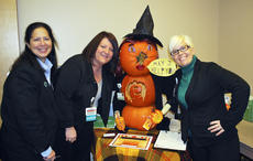 """<div class=""""source"""">Camille McClanahan</div><div class=""""image-desc"""">Lisa Holmes, Melody Dunaway and Julie Wright of the St. Elizabeth-Grant County registration department won best overall pumpkin at a contest held between each department in the hospital. </div><div class=""""buy-pic""""><a href=""""/photo_select/16105"""">Buy this photo</a></div>"""