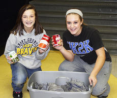 """<div class=""""source""""></div><div class=""""image-desc"""">Left, Matthew Barnett carries food donated to the Grant County Middle School annual food drive, while top, Jenna Martin and Tianna Thornberry sort the canned goods.  Photos submitted</div><div class=""""buy-pic""""></div>"""