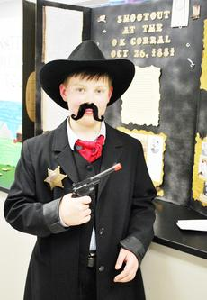 """<div class=""""source""""></div><div class=""""image-desc"""">Daniel Goderwis dressed in character for their social studies project. Goderwis presented his project on Wyatt Earp </div><div class=""""buy-pic""""><a href=""""/photo_select/17994"""">Buy this photo</a></div>"""