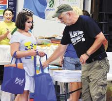 """<div class=""""source"""">Jerry Morris</div><div class=""""image-desc"""">Grant County 4-H Extension Agent Lamar Fowler hands out school supplies at the Back to School Bash at Grant County Park.</div><div class=""""buy-pic""""></div>"""