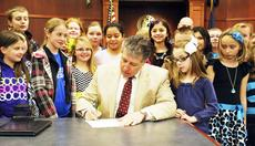 """<div class=""""source""""></div><div class=""""image-desc"""">Grant County Judge-Executive Darrell Link signed a proclamation recognizing Feb. 17 through Feb. 25 as Grant County Gifted and Talented Youth Week. Fourth and fifth grade gifted and talented students from Grant County schools witnessed the signing and then toured the Grant County Justice Center. The gifted and talented program is designed for students who demonstrate the ability to perform at high academic levels. Photo by Camille McClanahan</div><div class=""""buy-pic""""><a href=""""http://web2.lcni5.com/cgi-bin/c2newbuyphoto.cgi?pub=195&orig=pic%2B3_40.jpg"""" target=""""_new"""">Buy this photo</a></div>"""