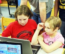 """<div class=""""source""""></div><div class=""""image-desc"""">Kimberlyn Price shows her little sister, Michaela Price, her work on the computer. Photos by Camille McClanahan </div><div class=""""buy-pic""""><a href=""""/photo_select/17912"""">Buy this photo</a></div>"""