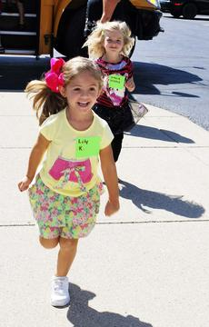 "<div class=""source""></div><div class=""image-desc"">Lily Kaffenberger and Gracie Green are excited about their visit to the Grant County Public Library as part of the Dry Ridge Elementary Kindercamp. The DRE Kindercamp is equipped to help students with the transition into kindergarten. Dry Ridge Elementary will also host a 'Boo-Hoo' breakfast on Aug. 13 for students and parents to make the transition into kindergarten easier. Photos by Camille McClanahan </div><div class=""buy-pic""><a href=""/photo_select/18467"">Buy this photo</a></div>"