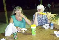 "<div class=""source""></div><div class=""image-desc"">Debbie Reinke of Verona enjoys a funnel cake. Photo by Billie Hutchinson</div><div class=""buy-pic""><a href=""http://web2.lcni5.com/cgi-bin/c2newbuyphoto.cgi?pub=195&orig=pic%2B3_70.jpg"" target=""_new"">Buy this photo</a></div>"