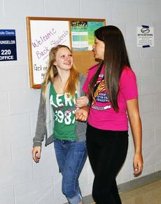 """<div class=""""source"""">Camille McClanahan</div><div class=""""image-desc"""">Grant County High School students Cherish Elliot and Kayla Rabe walk arm in arm during the first day. </div><div class=""""buy-pic""""></div>"""