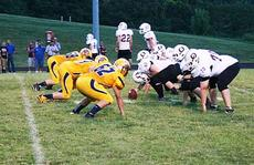 """<div class=""""source""""></div><div class=""""image-desc"""">    The Grant County Football team goes head-to- head with the Owen County Rebels.  Photos by  Austin Woods</div><div class=""""buy-pic""""><a href=""""/photo_select/18778"""">Buy this photo</a></div>"""