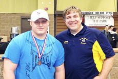 """<div class=""""source""""></div><div class=""""image-desc"""">Miskell and Coach Matt Shearer after he received his medal. Photos/information provided by Christine Miskell</div><div class=""""buy-pic""""><a href=""""/photo_select/16989"""">Buy this photo</a></div>"""