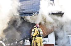 """<div class=""""source""""></div><div class=""""image-desc"""">Firefighters from five departments battled a fire on Greenville Road in Dry Ridge on March 19. Photos by Camille McClanahan</div><div class=""""buy-pic""""><a href=""""http://web2.lcni5.com/cgi-bin/c2newbuyphoto.cgi?pub=195&orig=pic%2B4_36.jpg"""" target=""""_new"""">Buy this photo</a></div>"""