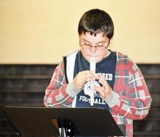 """<div class=""""source""""></div><div class=""""image-desc"""">Brayden Henson plays an instrument to show off his talent. </div><div class=""""buy-pic""""><a href=""""/photo_select/17997"""">Buy this photo</a></div>"""