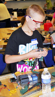 "<div class=""source""></div><div class=""image-desc"">Chase Nigg works on tracks at the Robotics Camp. </div><div class=""buy-pic""><a href=""/photo_select/18170"">Buy this photo</a></div>"
