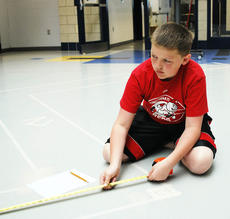 "<div class=""source""></div><div class=""image-desc"">Jacob Michels measures the path that his robot will take. </div><div class=""buy-pic""><a href=""/photo_select/18173"">Buy this photo</a></div>"