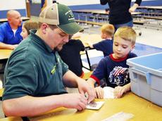 """<div class=""""source""""></div><div class=""""image-desc"""">Aaron Collins and his son, Tanner Collins, make a boat out of aluminum  foil.</div><div class=""""buy-pic""""><a href=""""http://web2.lcni5.com/cgi-bin/c2newbuyphoto.cgi?pub=195&orig=pic%2B7_31.jpg"""" target=""""_new"""">Buy this photo</a></div>"""