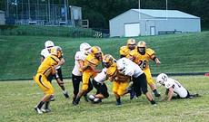 """<div class=""""source""""></div><div class=""""image-desc"""">Hunter Lawson helps his teammates battle the Rebels. Photos and article by Austin Woods </div><div class=""""buy-pic""""><a href=""""/photo_select/18777"""">Buy this photo</a></div>"""