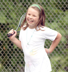 "<div class=""source""></div><div class=""image-desc"">Josie Smith smiles after hitting a ball during the Youth Tennis camp at Webb Park in Williamstown.</div><div class=""buy-pic""><a href=""/photo_select/18319"">Buy this photo</a></div>"