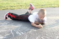 """<div class=""""source"""">Bryan Marshall</div><div class=""""image-desc"""">Williamstown Elementary third grader Draven Rains concentrates on writing his spelling words in chalk in the front parking lor. </div><div class=""""buy-pic""""></div>"""