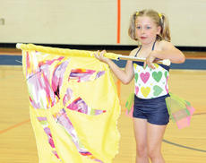 """<div class=""""source""""></div><div class=""""image-desc"""">Olivia Hedges does a dance and flag routine to earn herself a second-place finish.</div><div class=""""buy-pic""""><a href=""""http://web2.lcni5.com/cgi-bin/c2newbuyphoto.cgi?pub=195&orig=pic10_31.jpg"""" target=""""_new"""">Buy this photo</a></div>"""