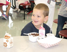 "<div class=""source""></div><div class=""image-desc"">CMZ first grader Devin Brune-Preito enjoys his breakfast. </div><div class=""buy-pic""><a href=""http://web2.lcni5.com/cgi-bin/c2newbuyphoto.cgi?pub=195&orig=pic10_37.jpg"" target=""_new"">Buy this photo</a></div>"