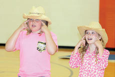 """<div class=""""source""""></div><div class=""""image-desc"""">Karelee Robinson, left, and Madison Laurent, right have a country theme to their performance.</div><div class=""""buy-pic""""><a href=""""http://web2.lcni5.com/cgi-bin/c2newbuyphoto.cgi?pub=195&orig=pic11_22.jpg"""" target=""""_new"""">Buy this photo</a></div>"""