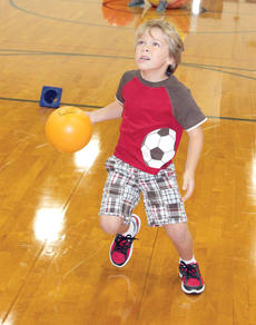 """<div class=""""source""""></div><div class=""""image-desc"""">Bryson Fornash looks determined as he prepares to shoot the ball into the basket.</div><div class=""""buy-pic""""><a href=""""/photo_select/21494"""">Buy this photo</a></div>"""