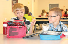 "<div class=""source""></div><div class=""image-desc"">WES second graders Gabe Partin and Gavin Dunn talk during lunch </div><div class=""buy-pic""><a href=""/photo_select/21522"">Buy this photo</a></div>"