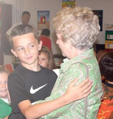 "<div class=""source""></div><div class=""image-desc"">Joel Surrett hesitates on giving his grandmother a hug in public at Williamstown Elementary. </div><div class=""buy-pic""><a href=""/photo_select/19176"">Buy this photo</a></div>"