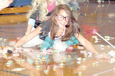 "<div class=""source""></div><div class=""image-desc"">Hannah Butcher has a good time gathering candy at an assembly at Crittenden-Mt. Zion Elementary School. Photo by Bryan Marshall </div><div class=""buy-pic""><a href=""http://web2.lcni5.com/cgi-bin/c2newbuyphoto.cgi?pub=195&orig=pic1_116.jpg"" target=""_new"">Buy this photo</a></div>"