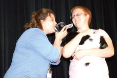 """<div class=""""source""""></div><div class=""""image-desc"""">Williamstown High School librarian Chantel March gives a kiss to a baby goat after students raised money during a fundraising drive for the school's Future Farmers of America club. Photos by Bryan Marshall</div><div class=""""buy-pic""""><a href=""""/photo_select/20295"""">Buy this photo</a></div>"""
