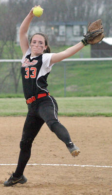"""<div class=""""source""""></div><div class=""""image-desc"""">Jade Pinkston winds up on the mound to prepare to pitch the ball to the plate. Photos by Wade Holland.</div><div class=""""buy-pic""""><a href=""""/photo_select/20393"""">Buy this photo</a></div>"""