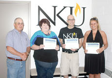"""<div class=""""source""""></div><div class=""""image-desc"""">Ronnie Gabbert of the Grant County Conservation District presents scholarships to NKU-Grant County students Katie Buckley, Shelli Johnson and Edward Denton.</div><div class=""""buy-pic""""><a href=""""/photo_select/18402"""">Buy this photo</a></div>"""