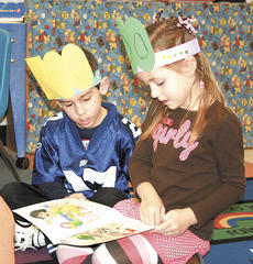 """<div class=""""source"""">Bryan Marshall</div><div class=""""image-desc"""">Williamstown kindergartners Chase Simpson, left, and Caden O'Connor, right, share a book together while wearing 100th day hats they made in class. </div><div class=""""buy-pic""""><a href=""""/photo_select/13357"""">Buy this photo</a></div>"""