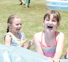 "<div class=""source""></div><div class=""image-desc"">McKenna Simpson and Abby Knarr share a laugh during the annual Little Dippers program for ages 4 through 6. The event featured crafts, as well as water activities. Photos by Bryan Marshall</div><div class=""buy-pic""><a href=""/photo_select/18186"">Buy this photo</a></div>"
