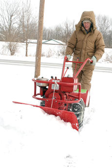 """<div class=""""source""""></div><div class=""""image-desc"""">Snow and ice covered U.S. 25 on Tuesday morning. Paul Haefling of Dry Ridge didn't let the snow get him down, he just got out the snow blower. Photos by Bryan Marshall</div><div class=""""buy-pic""""><a href=""""/photo_select/19717"""">Buy this photo</a></div>"""