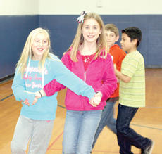 """<div class=""""source""""></div><div class=""""image-desc"""">Haley Padgett and Kaitlyn Wilson do-si-do to music. </div><div class=""""buy-pic""""><a href=""""/photo_select/20160"""">Buy this photo</a></div>"""