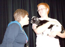 """<div class=""""source""""></div><div class=""""image-desc"""">Kathy Shoemaker leans in to give a kiss to the baby goat in front of WHS students during lunch.</div><div class=""""buy-pic""""><a href=""""/photo_select/20296"""">Buy this photo</a></div>"""