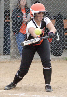 """<div class=""""source""""></div><div class=""""image-desc"""">WHS Lady Demon Kristine Robertson keeps her eye on the ball as she swings the bat during a recent softball game.</div><div class=""""buy-pic""""><a href=""""/photo_select/20394"""">Buy this photo</a></div>"""