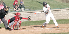 "<div class=""source""></div><div class=""image-desc"">WHS baseball player Jacob Scroggins swings as the ball approaches the plate during a recent home game. Photos by Wade Holland</div><div class=""buy-pic""><a href=""http://web2.lcni5.com/cgi-bin/c2newbuyphoto.cgi?pub=195&orig=pic2_119.jpg"" target=""_new"">Buy this photo</a></div>"