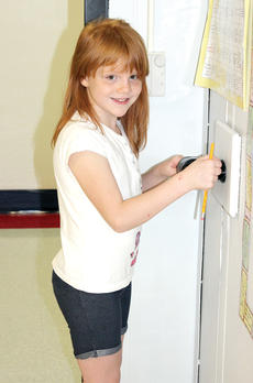 "<div class=""source""></div><div class=""image-desc"">CMZ second grader Karrigan Robinson makes sure her pencil is sharp.</div><div class=""buy-pic""><a href=""http://web2.lcni5.com/cgi-bin/c2newbuyphoto.cgi?pub=195&orig=pic2_149.jpg"" target=""_new"">Buy this photo</a></div>"