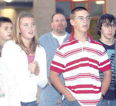 "<div class=""source"">Bryan Marshall</div><div class=""image-desc"">Carly Middleton, left, and Tyler Nickell, right, sing along as part of See You At The Pole at Williamstown Schools.</div><div class=""buy-pic""><a href=""/photo_select/12322"">Buy this photo</a></div>"