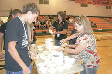 "<div class=""source"">Bryan Marshall</div><div class=""image-desc"">Tammy McClelland, assistant/registrar for the Williamstown Family Resource Center and Sheila Whaley, secretary, dish up ice cream to Andrew Jones. </div><div class=""buy-pic""><a href=""/photo_select/12810"">Buy this photo</a></div>"