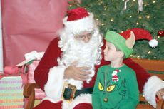 "<div class=""source""></div><div class=""image-desc"">Santa gives Carson Cobb a few pointers on being his elf. Photo by Bryan Marshall </div><div class=""buy-pic""><a href=""http://web2.lcni5.com/cgi-bin/c2newbuyphoto.cgi?pub=195&orig=pic2_42.jpg"" target=""_new"">Buy this photo</a></div>"