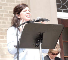 "<div class=""source""></div><div class=""image-desc"">Kaira McKinnon, youth coordinator at the Family Worship Center Grant County, leads in prayer at the Grant County Courthouse in Williamstown. </div><div class=""buy-pic""><a href=""/photo_select/17720"">Buy this photo</a></div>"
