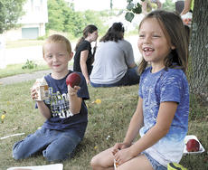 """<div class=""""source""""></div><div class=""""image-desc"""">Nathaniel and Destiny Brown, above, share a snack</div><div class=""""buy-pic""""><a href=""""/photo_select/21226"""">Buy this photo</a></div>"""
